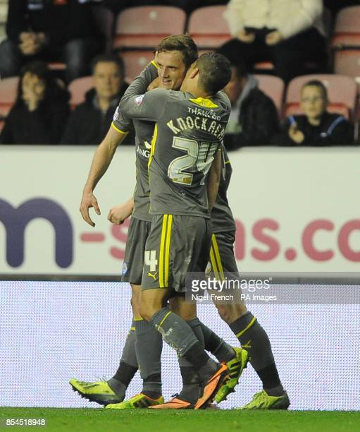 Leicester City's Andy King celebrates with Anthony Knockaert after scoring his sides opening goal of the game against Wigan Athletic during the Sky...