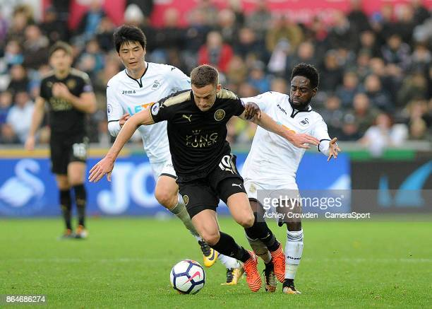 Leicester City's Andy King is fouled by Swansea City's Nathan Dyer during the Premier League match between Swansea City and Leicester City at Liberty...