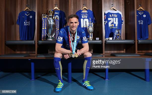Leicester City's Andy King shows off the League 1 Trophy Championship Trophy and Premier League Trophy the only player to have won each with the same...