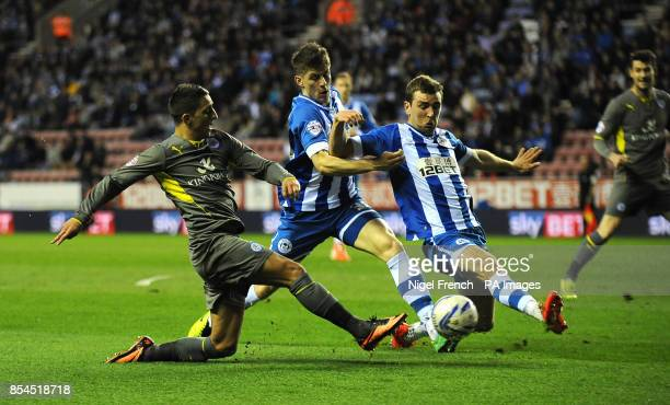 Leicester City's Anthony Knockaert crosses the ball under pressure from Wigan Athletic's James McArthur during the Sky Bet Championship match at the...