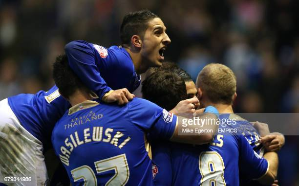 Leicester City's Anthony Knockaert jumps on top of goalscorer Riyad Mahrez as celebrates the first goal