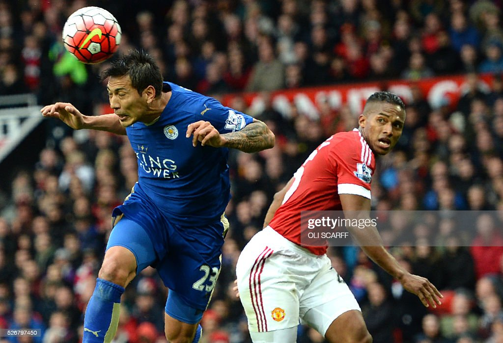 Leicester City's Argentinian striker Leonardo Ulloa (L) beats Manchester United's Ecuadorian midfielder Antonio Valencia (R) to head the ball during the English Premier League football match between Manchester United and Leicester City at Old Trafford in Manchester, north west England, on May 1, 2016. / AFP / OLI SCARFF / RESTRICTED TO EDITORIAL USE. No use with unauthorized audio, video, data, fixture lists, club/league logos or 'live' services. Online in-match use limited to 75 images, no video emulation. No use in betting, games or single club/league/player publications. /