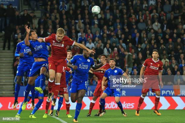 Leicester City's Argentinian striker Leonardo Ulloa vies with Liverpool's Estonian defender Ragnar Klavan during the English League Cup third round...