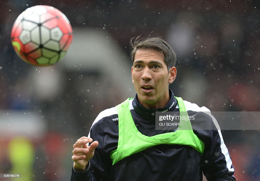 Leicester City's Argentinian striker Leonardo Ulloa warms up before the English Premier League football match between Manchester United and Leicester City at Old Trafford in Manchester, north west England, on May 1, 2016. / AFP / OLI SCARFF / RESTRICTED TO EDITORIAL USE. No use with unauthorized audio, video, data, fixture lists, club/league logos or 'live' services. Online in-match use limited to 75 images, no video emulation. No use in betting, games or single club/league/player publications. /