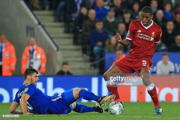 Leicester City's Austrian defender Aleksandar Dragovic vies with Liverpool's Dutch midfielder Georginio Wijnaldum during the English League Cup third...