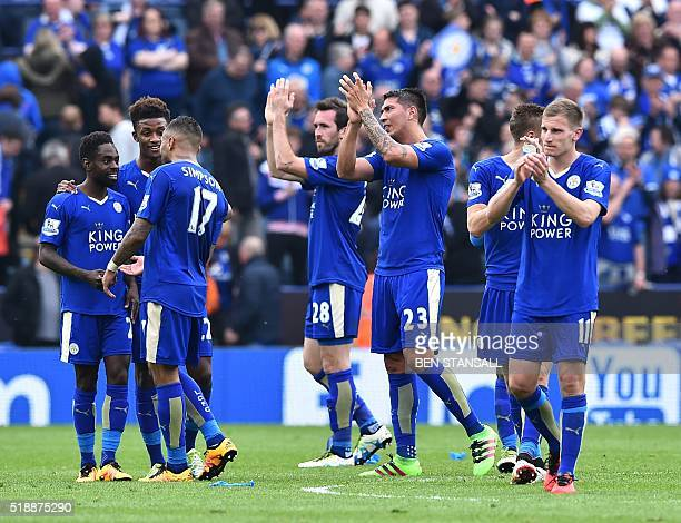 Leicester City's Austrian defender Christian Fuchs and Leicester City's Argentinian striker Leonardo Ulloa applaud fans after winning the English...