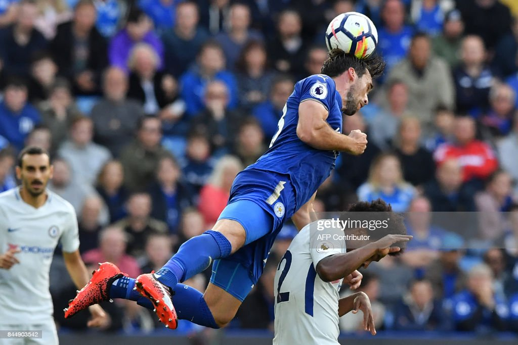TOPSHOT - Leicester City's Austrian defender Christian Fuchs wins a header from Chelsea's Brazilian midfielder Willian during the English Premier League football match between Leicester City and Chelsea at King Power Stadium in Leicester, central England on September 9, 2017. Chelsea won the game 2-1. / AFP PHOTO / Ben STANSALL / RESTRICTED TO EDITORIAL USE. No use with unauthorized audio, video, data, fixture lists, club/league logos or 'live' services. Online in-match use limited to 75 images, no video emulation. No use in betting, games or single club/league/player publications. /