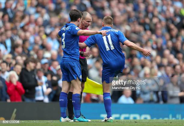 Leicester City's Ben Chillwell and Leicester City's Marc Albrighton question a goal with the linesman