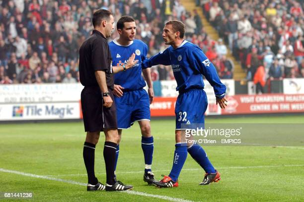 Leicester City's Billy McKinlay goes to argue with referee Rob Styles as teammate Muzzy Izzet looks on