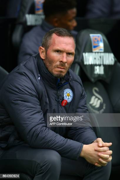 Leicester City's caretaker manager Michael Appleton awaits kick off in the English Premier League football match between Swansea City and Leicester...