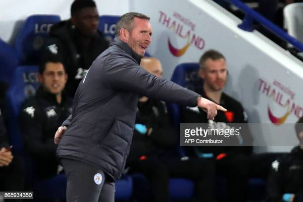 Leicester City's caretaker manager Michael Appleton gestures on the touchline during the English League Cup fourth round football match between...