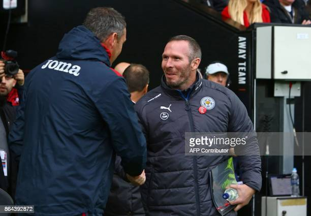 Leicester City's caretaker manager Michael Appleton shakes hands with Swansea City's English head coach Paul Clement ahead of the English Premier...