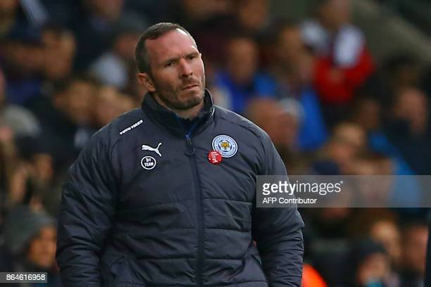 Leicester City's caretaker manager Michael Appleton watches from the touchline during the English Premier League football match between Swansea City...