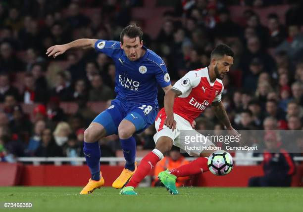 Leicester City's Christian Fuchs and Arsenal's Theo Walcott during the Premier League match between Arsenal and Leicester City at Emirates Stadium on...