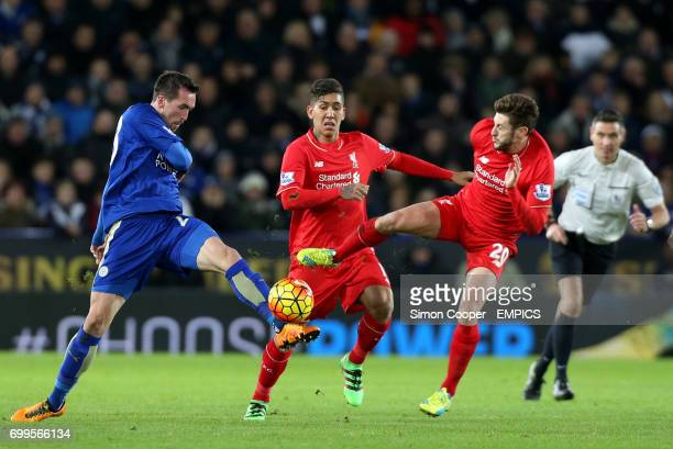 Leicester City's Christian Fuchs and Liverpool's Adam Lallana battle for the ball