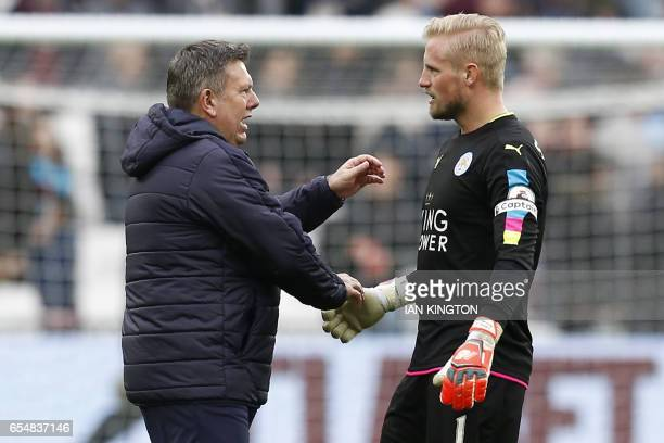 Leicester City's Danish goalkeeper Kasper Schmeichel and Leicester City's English manager Craig Shakespeare shake hands on the pitch after the...