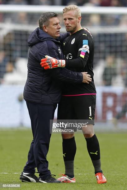 Leicester City's Danish goalkeeper Kasper Schmeichel and Leicester City's English manager Craig Shakespeare celebrate on the pitch after the English...