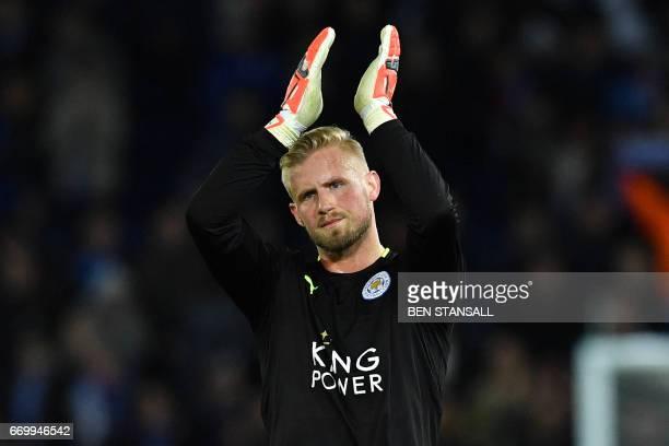 Leicester City's Danish goalkeeper Kasper Schmeichel applauds the fans following the UEFA Champions League quarterfinal second leg football match...