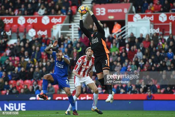 TOPSHOT Leicester City's Danish goalkeeper Kasper Schmeichel catches the ball during the English Premier League football match between Stoke City and...