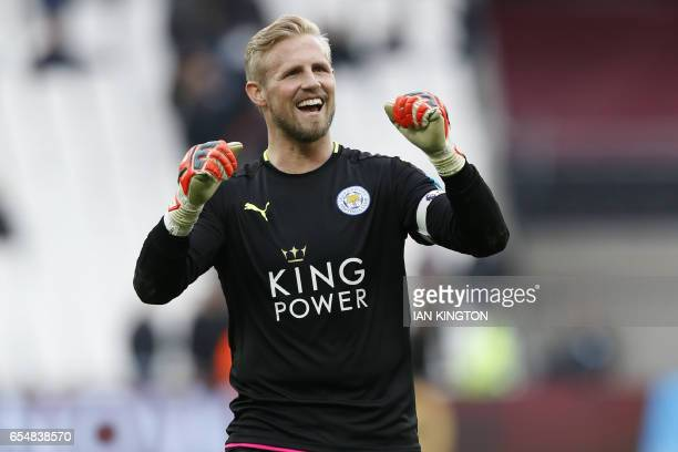Leicester City's Danish goalkeeper Kasper Schmeichel celebrates on the pitch after the English Premier League football match between West Ham United...