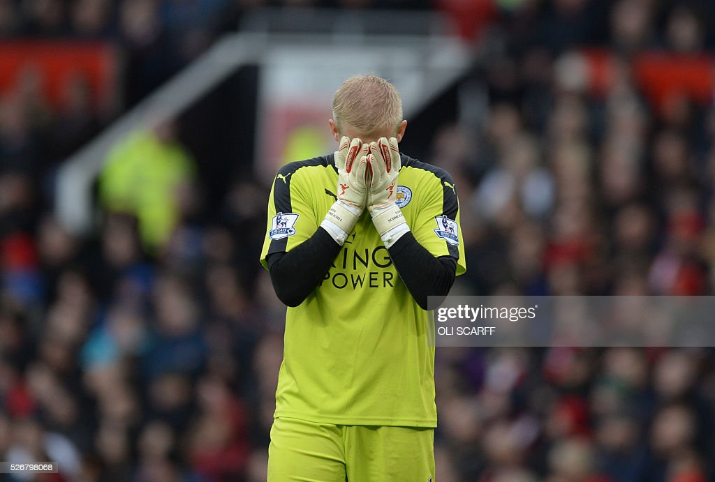 Leicester City's Danish goalkeeper Kasper Schmeichel covers his face after a chance for his team down the other end of the pitch during the English Premier League football match between Manchester United and Leicester City at Old Trafford in Manchester, north west England, on May 1, 2016. / AFP / OLI SCARFF / RESTRICTED TO EDITORIAL USE. No use with unauthorized audio, video, data, fixture lists, club/league logos or 'live' services. Online in-match use limited to 75 images, no video emulation. No use in betting, games or single club/league/player publications. /