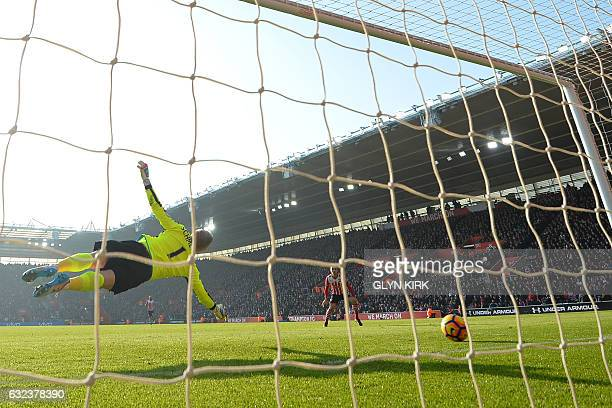 Leicester City's Danish goalkeeper Kasper Schmeichel dives but cannot prevent James WardProwse's shot beat him for Southampton's first goal during...