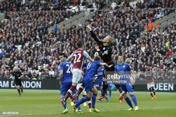 Leicester City's Danish goalkeeper Kasper Schmeichel punches the ball away during the English Premier League football match between West Ham United...