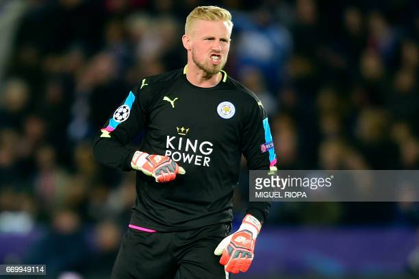 Leicester City's Danish goalkeeper Kasper Schmeichel reacts during the UEFA Champions League quarterfinal second leg football match between Leicester...