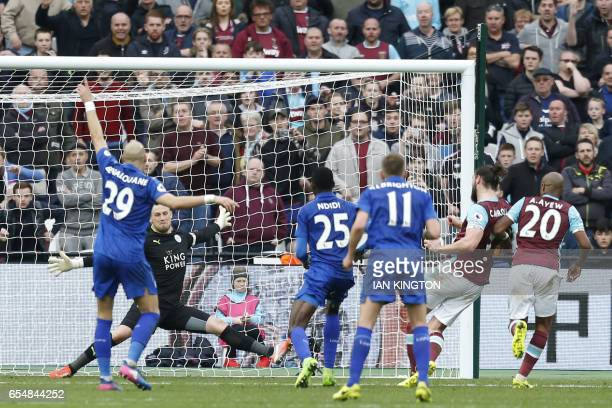Leicester City's Danish goalkeeper Kasper Schmeichel saves a shot by West Ham's Andy Carroll during the English Premier League football match between...