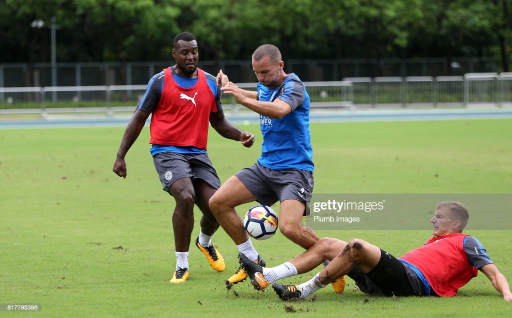 Leicester City's Danny Drinkwater under pressure from Marc Albrighton and Wes Morgan trains in the Hong Kong heat ahead of the Premier League Asia Trophy on July 18th , 2017 in Hong Kong, Hong Kong.