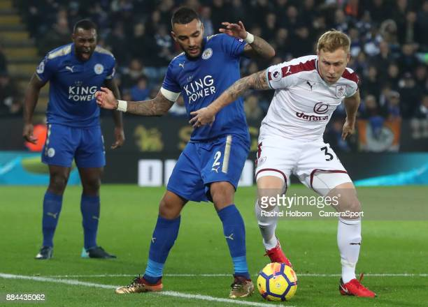 Leicester City's Danny Simpson and Burnley's Scott Arfield during the Premier League match between Leicester City and Burnley at The King Power...