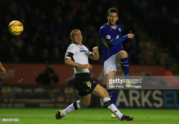 Leicester City's David Nugent shoots after beating Derby County defender Jake Buxton during the Sky Bet Championship match at the King Power Stadium...