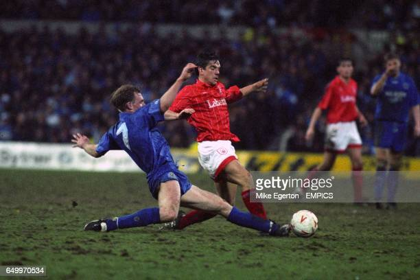 Leicester City's David Oldfield slide tackles Nottingham Forest's Dave Phillips