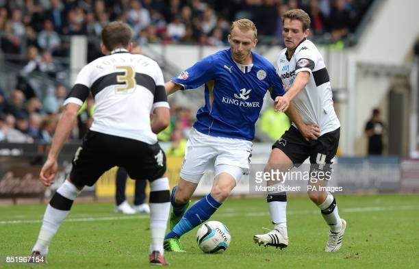 Leicester City's Eitchie De Laet battles for the ball with Derby County's Craig Bryson and Craig Forsyth during the Sky Bet Football League...