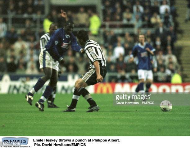Leicester City's Emile Heskey throws a punch at Newcastle United's Philippe Albert