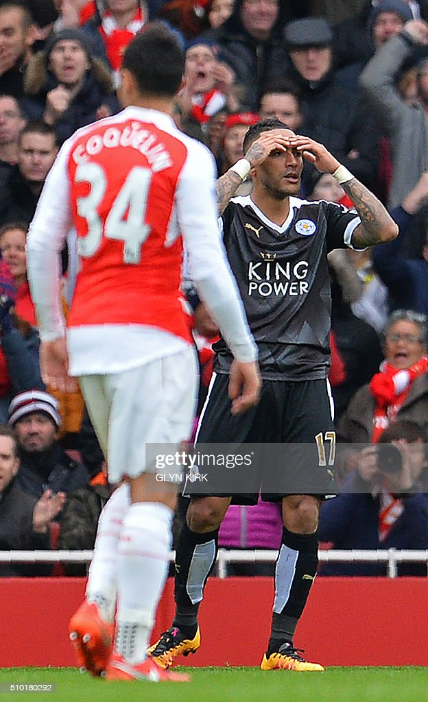 Leicester City's English defender Danny Simpson (R) reacts as referee Martin Atkinson (not pictured) shows him a red card after he received a second yellow card during the English Premier League football match between Arsenal and Leicester at the Emirates Stadium in London on February 14, 2016. / AFP / GLYN KIRK / RESTRICTED TO EDITORIAL USE. No use with unauthorized audio, video, data, fixture lists, club/league logos or 'live' services. Online in-match use limited to 75 images, no video emulation. No use in betting, games or single club/league/player publications. /