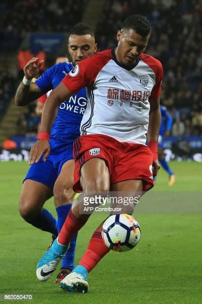 Leicester City's English defender Danny Simpson vies with West Bromwich Albion's Venezuelan striker Salomon Rondon during the English Premier League...