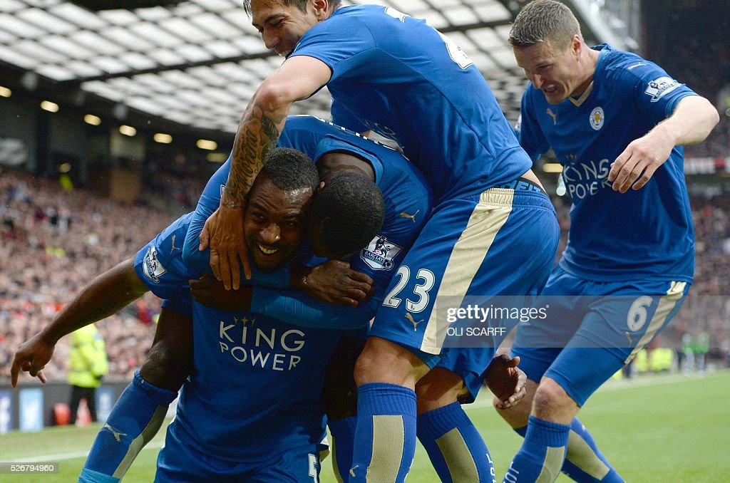 Leicester City's English defender Wes Morgan (L) celebrates scoring the equalising 1-1 goal during the English Premier League football match between Manchester United and Leicester City at Old Trafford in Manchester, north west England, on May 1, 2016. / AFP / OLI SCARFF / RESTRICTED TO EDITORIAL USE. No use with unauthorized audio, video, data, fixture lists, club/league logos or 'live' services. Online in-match use limited to 75 images, no video emulation. No use in betting, games or single club/league/player publications. /