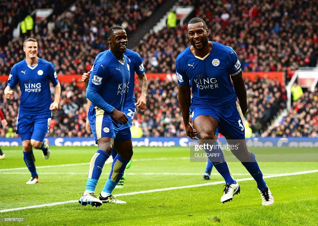 Leicester City's English defender Wes Morgan (R) celebrates scoring the equalising 1-1 goal during the English Premier League football match between Manchester United and Leicester City at Old Trafford in Manchester, north west England, on May 1, 2016. / AFP / OLI SCARFF / RESTRICTED TO EDITORIAL USE. No use with unauthorized audio, video, data, fixture lists, club/league logos or 'live' services. Online in-match use limited to 75 images, no video emulation. No use in betting, games or single club/league/player publications. /