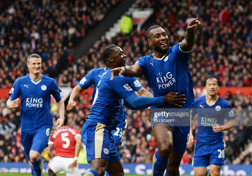 Leicester City's English defender Wes Morgan (R) celebrates scoring the equalising 1-1 goal with Leicester City's Ghanaian striker Jeff Schlupp (L) during the English Premier League football match between Manchester United and Leicester City at Old Trafford in Manchester, north west England, on May 1, 2016. / AFP / OLI SCARFF / RESTRICTED TO EDITORIAL USE. No use with unauthorized audio, video, data, fixture lists, club/league logos or 'live' services. Online in-match use limited to 75 images, no video emulation. No use in betting, games or single club/league/player publications. /
