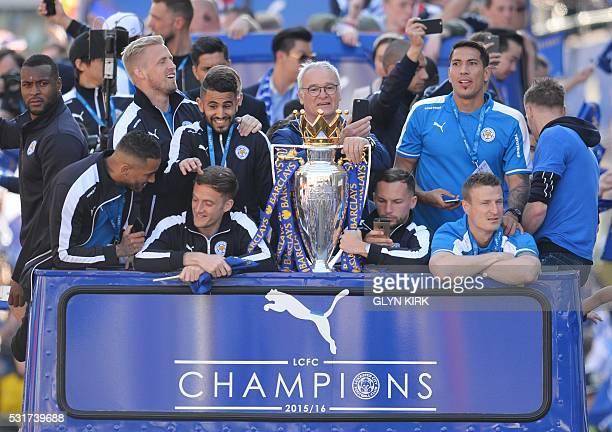 Leicester City's English defender Wes Morgan Leicester City's Danish goalkeeper Kasper Schmeichel Leicester City's Algerian midfielder Riyad Mahrez...