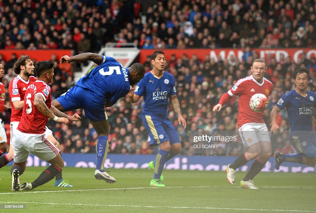 Leicester City's English defender Wes Morgan (3L) scores the equalising 1-1 goal during the English Premier League football match between Manchester United and Leicester City at Old Trafford in Manchester, north west England, on May 1, 2016. / AFP / OLI SCARFF / RESTRICTED TO EDITORIAL USE. No use with unauthorized audio, video, data, fixture lists, club/league logos or 'live' services. Online in-match use limited to 75 images, no video emulation. No use in betting, games or single club/league/player publications. /