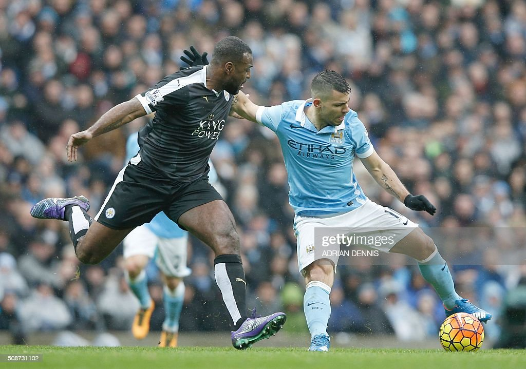 Leicester City's English defender Wes Morgan (L) vies with Manchester City's Argentinian striker Sergio Aguero during the English Premier League football match between Manchester City and Leicester City at the Etihad Stadium in Manchester, north west England, on February 6, 2016. / AFP / ADRIAN DENNIS / RESTRICTED TO EDITORIAL USE. No use with unauthorized audio, video, data, fixture lists, club/league logos or 'live' services. Online in-match use limited to 75 images, no video emulation. No use in betting, games or single club/league/player publications. /