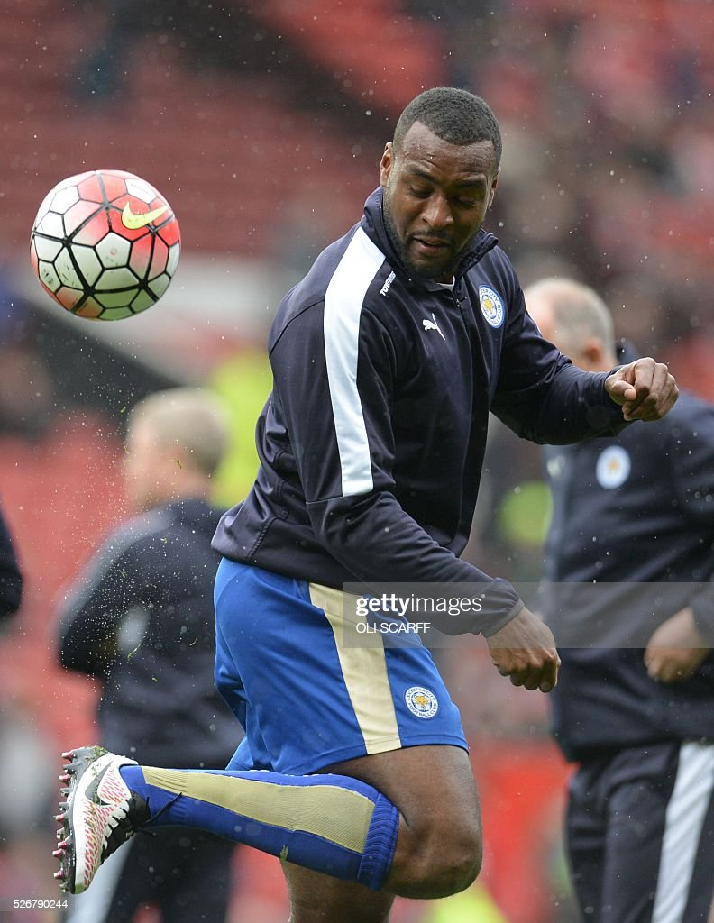 Leicester City's English defender Wes Morgan warms up before the English Premier League football match between Manchester United and Leicester City at Old Trafford in Manchester, north west England, on May 1, 2016. / AFP / OLI SCARFF / RESTRICTED TO EDITORIAL USE. No use with unauthorized audio, video, data, fixture lists, club/league logos or 'live' services. Online in-match use limited to 75 images, no video emulation. No use in betting, games or single club/league/player publications. /