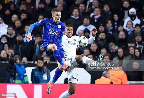 Leicester City's English forward Jamie Vardy vies with FC Copenhagen's Danish defender Mathias Jorgensen during the UEFA Champions League group G...