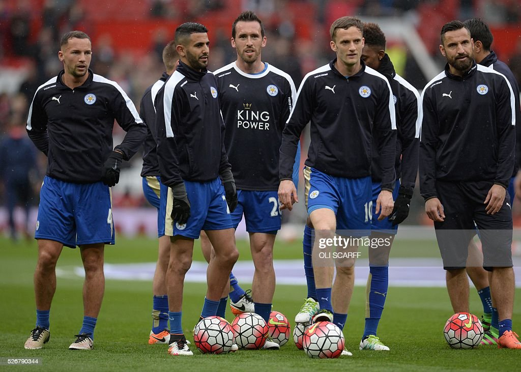 Leicester City's English midfielder Danny Drinkwater (L) and Leicester City's Algerian midfielder Riyad Mahrez (2L) warm up before the English Premier League football match between Manchester United and Leicester City at Old Trafford in Manchester, north west England, on May 1, 2016. / AFP / OLI SCARFF / RESTRICTED TO EDITORIAL USE. No use with unauthorized audio, video, data, fixture lists, club/league logos or 'live' services. Online in-match use limited to 75 images, no video emulation. No use in betting, games or single club/league/player publications. /