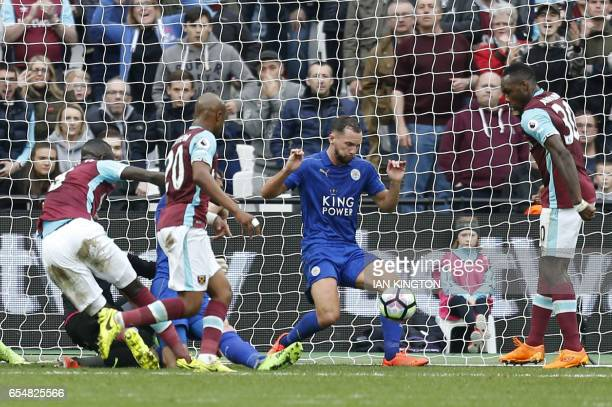 Leicester City's English midfielder Danny Drinkwater blocks a shot on the goal line during the English Premier League football match between West Ham...