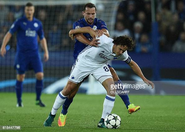 Leicester City's English midfielder Danny Drinkwater vies with FC Copenhagen's Danish midfielder Thomas Delaney during the UEFA Champions League...
