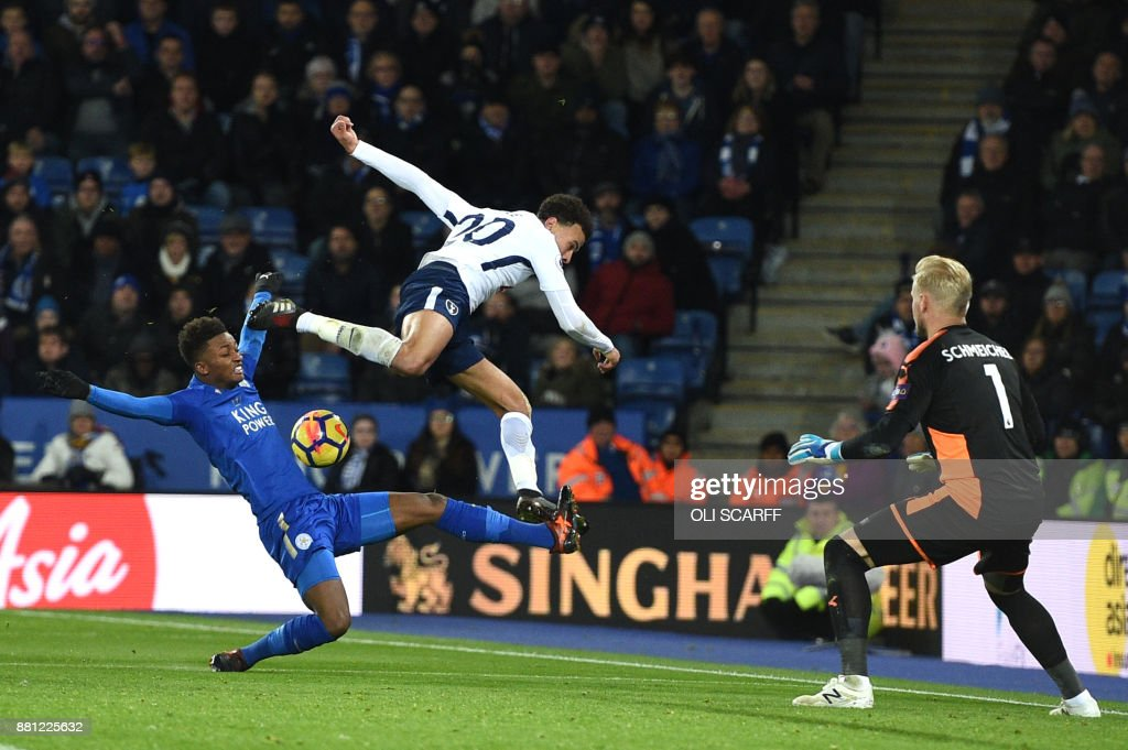 Leicester City's English midfielder Demarai Gray (L) vies with Tottenham Hotspur's English midfielder Dele Alli by Leicester City's Danish goalkeeper Kasper Schmeichel during the English Premier League football match between Leicester City and Tottenham Hotspur at King Power Stadium in Leicester, central England on November 28, 2017. / AFP PHOTO / Oli SCARFF / RESTRICTED TO EDITORIAL USE. No use with unauthorized audio, video, data, fixture lists, club/league logos or 'live' services. Online in-match use limited to 75 images, no video emulation. No use in betting, games or single club/league/player publications. /