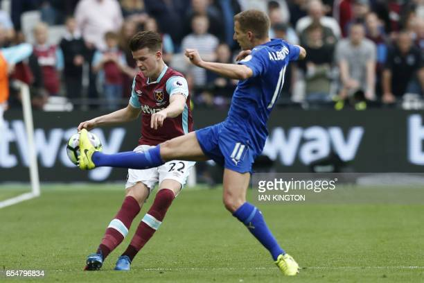 Leicester City's English midfielder Marc Albrighton blocks West Ham United's English defender Sam Byram during the English Premier League football...